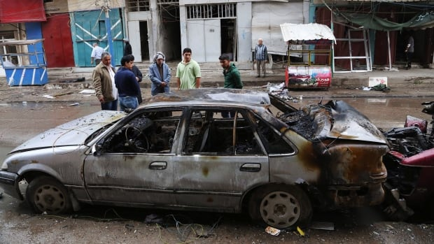A car bomb targeting a street full of shoppers in the capital of Iraq on Saturday killed and wounded civilians, police said.