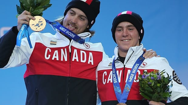 Mac Marcoux, right, and his guide Robin Femy celebrate their bronze-medal win in the men's super-G at the Sochi Paralympics on Sunday. It is their second medal of the Games.