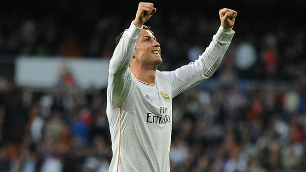 Cristiano Ronaldo of Real Madrid celebrates after scoring against Levante UD at Santiago Bernabeu stadium on March 9, 2014 in Madrid, Spain.