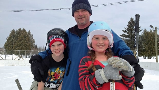 Andy Cameron took advantage of the mild weather to bring his children, Josh and MacKenna, to the Carrick Park rink in Thunder Bay on Sunday.