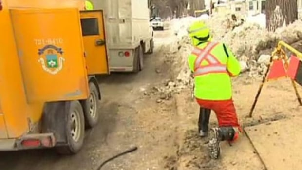 A city worker tackles a frozen pipe in Winnipeg. Officials announced Tuesday they are now waiving fees for citizens who have had their pipes thawed since Feb. 28.