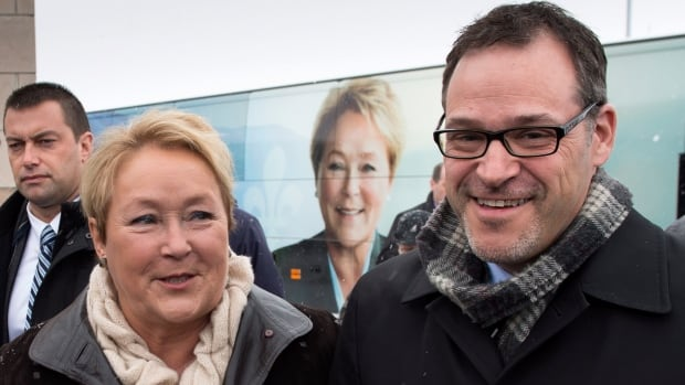PQ leader Pauline Marois arrives with candidate Simon Prevost during a campaign stop Monday in Saint-Bruno-de-Montarville, Que.