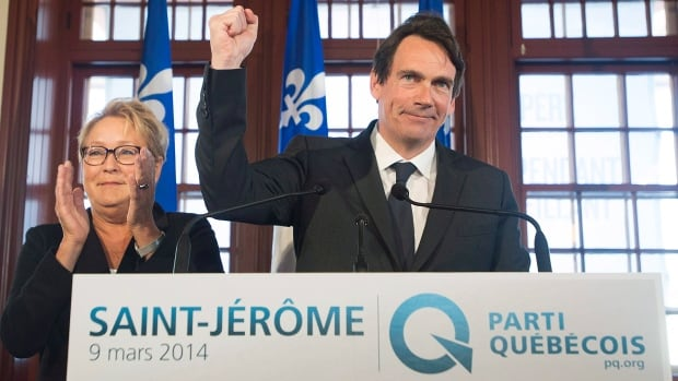 Parti Québécois leader Pauline Marois looks on as Pierre Karl Péladeau gestures during a press conference announcing his candidacy in the riding of Saint-Jérôme.