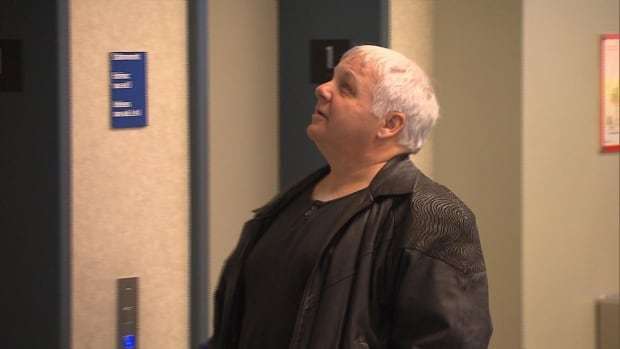 Joleil Campeau's father waits outside the courtroom. Éric Daudelin is accused of first-degree murder, sexual assault and forcible confinement of Campeau.