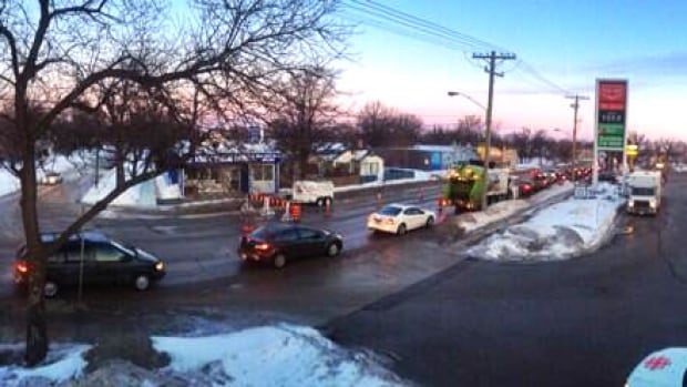 Morning commuters line up along Archibald Street on Tuesday, where traffic was down to one lane in each direction due to water main repairs in the area.