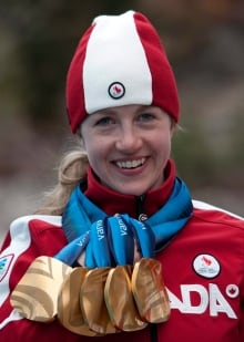 Lauren Woolstencroft and her five Paralympic gold medals
