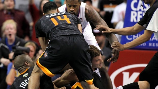 Phoenix Suns forward P.J. Tucker, left, gets in an altercation with Los Angeles Clippers forward Blake Griffin, right, as Suns guard Gerald Green (14) and Clippers center DeAndre Jordan get into the scrum during a game on Monday, in Los Angeles. Suns Tucker was ejected from the game as the Clippers won 112-105.
