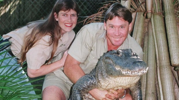 The late Steve Irwin, known as The Crocodile Hunter, is seen in this 1999 photo with his wife Terri and a nine-foot alligator in Beerwah, Queensland. Irwin knew he was dying after a massive stingray stabbed him in the chest hundreds of times, the only witness to the fatal 2006 attack has revealed in the first detailed public account of the beloved conservationist's death.