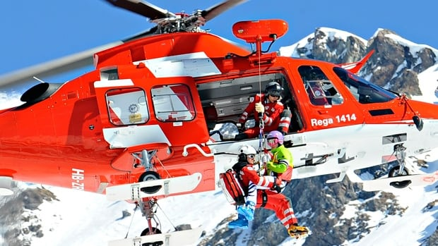 Maria Hoefl-Riesch of Germany is helicoptered off the course after having crashed on  on Wednesday in Lenzerheide, Switzerland.