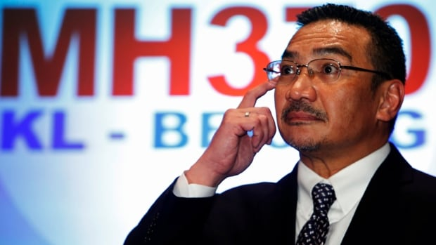 Malaysia's acting Transport Minister Hishammuddin Hussein answers questions during a news conference about the missing Malaysia Airlines MH370 plane. Days after it went missing, authorities are no closer to explaining what happened to the plane.