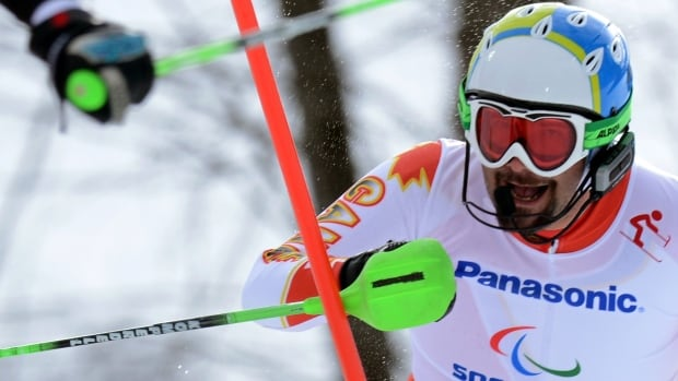 Canada's Chris Williamson competes in the second run of the men's visually impaired slalom race — and finishes third.
