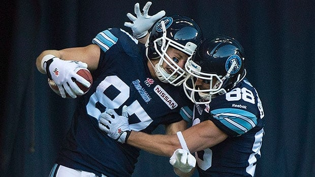 Argonauts fullback Alexander Robinson, left, had 10 catches for 117 yards and two touchdowns last season with the Toronto Argonauts.