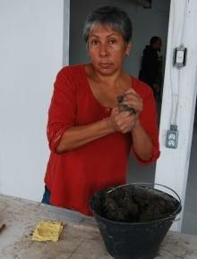 Rebecca Belmore making clay beads