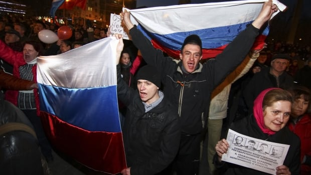 Pro-Russian demonstrators take part in a rally in Donetsk Thursday, where hundreds of Ukrainian demonstrators clashed in the city in eastern Ukraine.