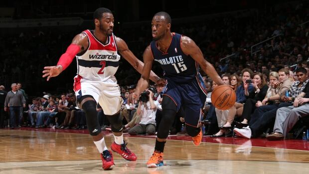 John Wall of the Washington Wizards, left, was particularly upset that was called for fouling Kemba Walker of the Charlotte Bobcats, right, during Walker's 3-point attempt in the fourth quarter.
