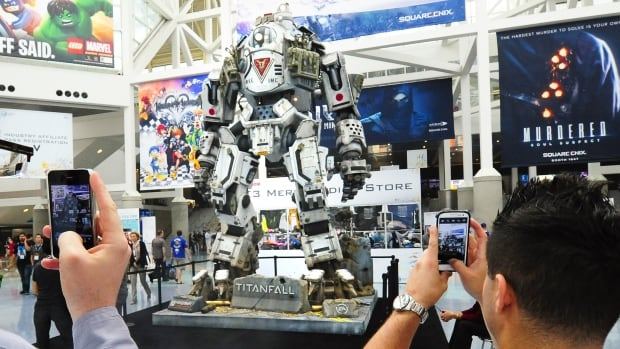 A full-sized robot depicted from the new game Titanfall is photographed by fans during the Electronic Entertainment Expo in Los Angeles.