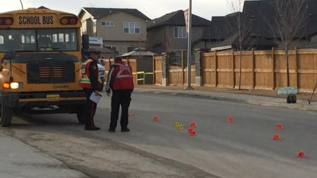 Police investigate the scene where a child was hit by a car Thursday afternoon.