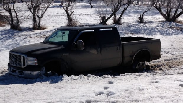 A truck with three blown tires, driven by a robbery suspect, was finally stopped by a pile of snow.