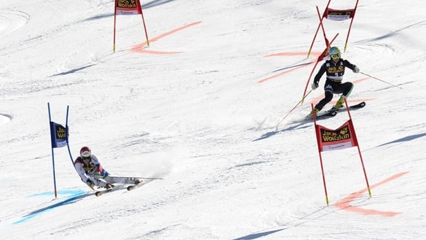 Switzerland's Reto Schmidiger, left, competes with Italy's Roberto Nani during the nation team event on Friday in Lenzerheide. Switzerland beat the United States to win the mixed team event at the World Cup finals on home snow at Lenzerheide.