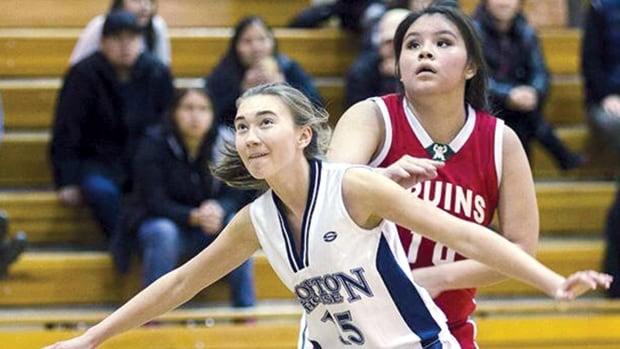Allie Keitlah plays the post position for her high school team,  Britannia Bruins. Keitlah [right], is vying for the ball during a school game against Crofton House [left].