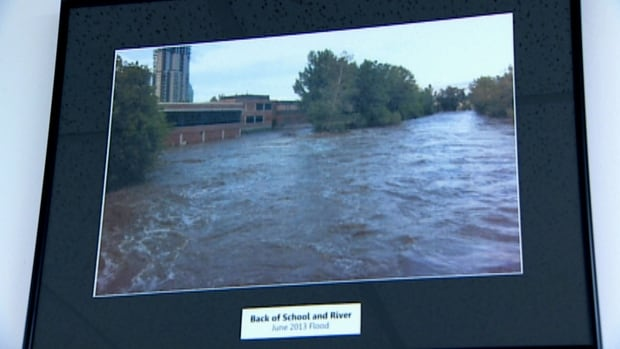 A photo from last June shows the swollen Elbow River engulfing St. Mary's High School in Calgary.