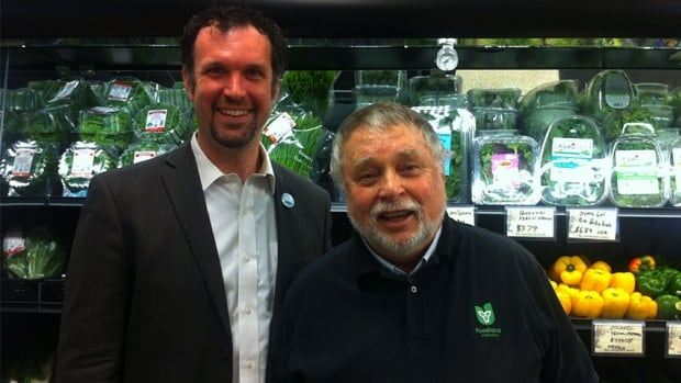 Graham Cubitt and Ted McMeekin pose together at Mustard Seed Co-op in downtown Hamilton. McMeekin announced the province will provide funding for the co-op Friday morning.