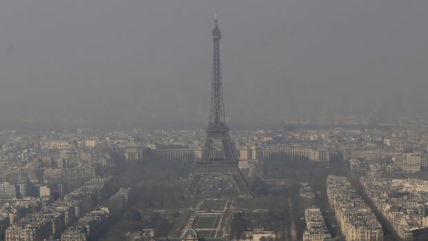 The Eiffel Tower is barely seen through the smog from Paris on Friday, March 14.  Nearly three-quarters of France is under alert in what the European Environment Agency says is the worst air pollution since 2007.