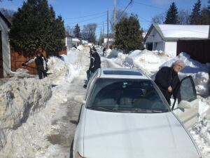 Windrow shovelling in River Heights