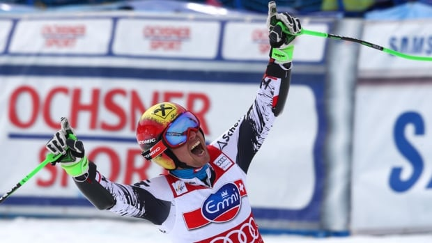 Austria's Marcel Hirscher celebrates at the finish area after taking fourth place in men's giant slalom at the World Cup finals in Lenzerheide, Switzerland on Saturday.