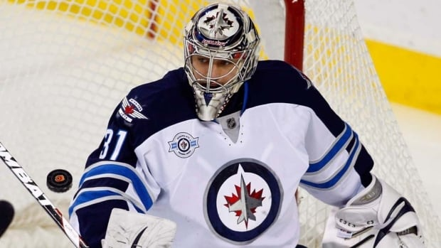Winnipeg Jets goalie Ondrej Pavelec is out with a lower body injury, the team said Saturday.
