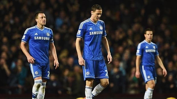 John Terry, Nemanja Matic and Cesar Azpilicueta of Chelsea look dejected after a goal by Aston Villa at Villa Park on March 15, 2014 in Birmingham, England.