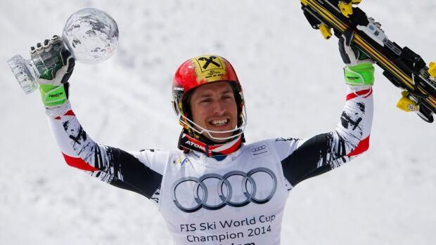 Marcel Hirscher of Austria lifts the crystal globe as overall winner of the men's alpine skiing slalom World Cup in Lenzerheide, Switzerland on Sunday.
