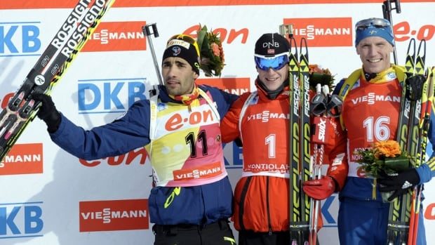 Norway's Johannes Thingnes Boe, centre, won the men's 12.5 km pursuit at the IBU World Cup Biathlon event in Kontiolahti, Eastern Finland on Sunday. Martin Fourcade, left, came second, while Sweden's Björn Ferry took third place.