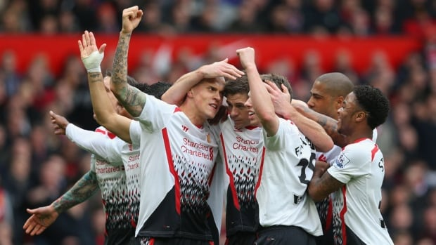 Steven Gerrard of Liverpool celebrates scoring the first goal with his teammates against Manchester United at Old Trafford on Sunday in Manchester, England.