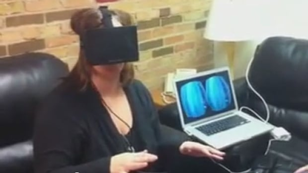 Information Radio host Marcy Markusa tried out the Oculus Rift, a virtual reality headset designed for immersive 3D gaming.