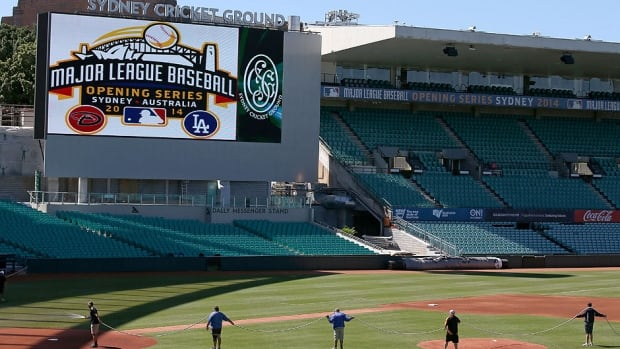 Ground staff prepare the baseball field that has been especially built for the Major League Baseball opening series at the Sydney Cricket Ground in Australia. The Los Angeles Dodgers open a two-game series with the Arizona Diamondbacks on Saturday.