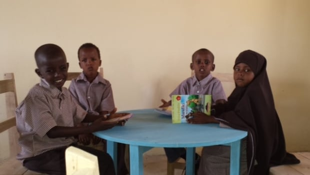 Students read at a preschoolin Dadaab, Kenya, one of the largest refugee camps in the country. Winnipegger Muuxi Adam helped found the preschool.