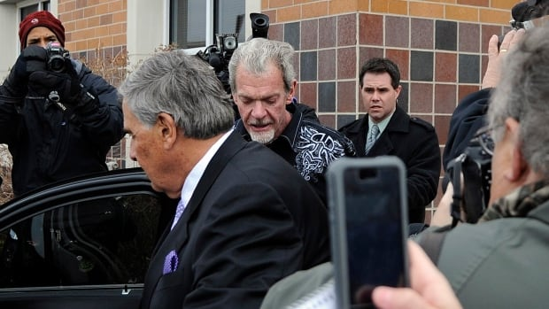 Attorney James Voyles, centre left,  and Indianapolis Colts owner Jim Irsay, center right,  are shown leaving the Hamilton County Jail on Monday.