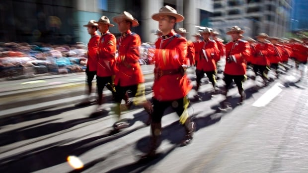 Members of the Royal Canadian Mounted Police are seen here marching during the Calgary Stampede parade in 2012.