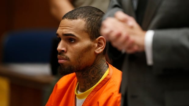 R&B singer Chris Brown, center, appears in Los Angeles Superior Court on Monday. Brown will spend another month in jail after his troubling comments in rehab about being good at using guns and knives and his dismissal from a Malibu facility where he was receiving treatment for anger management, substance abuse and issues related to bipolar disorder.