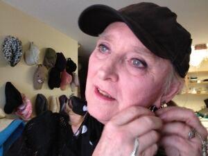Nanci Blu, adjusting her earrings
