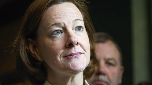 Alberta Premier Alison Redford scrums with the media following a meeting of the provincial PC Party executive in Calgary Saturday.