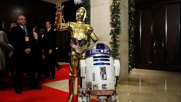 Star Wars characters C-3PO, left, and R2D2 appear at an event in Beverly Hills, Calif. in 2008. Disney CEO Bob Iger confirmed only that R2D2 would return in the upcoming Star Wars sequel, declining to reveal any other casting news.