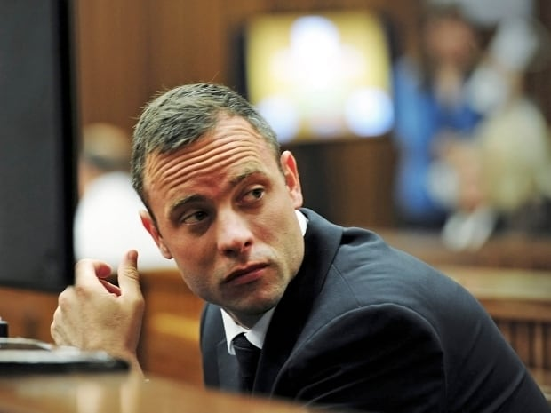 Olympic and Paralympic track star Oscar Pistorius sits in the dock at the North Gauteng High Court in Pretoria, South Africa, on Wednesday. Pistorius is on trial accused of murdering his girlfriend Reeva Steenkamp at his suburban Pretoria home on Valentine's Day last year.