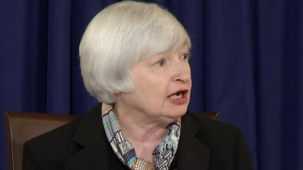 New Fed chair Janet Yellen speaks to reporters Wednesday in Washington. She said the Fed is watching twin targets - inflation and unemployment - in its efforts to decide when to raise rates.