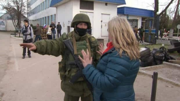 Reporter moved away from Crimea naval base