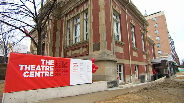 Outside the grand opening of the Theatre Centre in a refurbished Carnegie Library on Queen West.