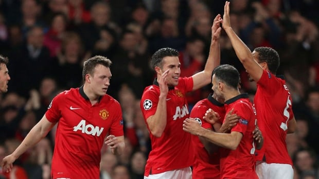 Manchester United striker Robin van Persie, centre, scored a hat trick against Olympiakos in Champions League action Wednesday.