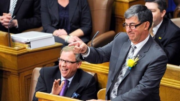 Saskatchewan Finance Minister Ken Krawetz points across to the opposition as he delivers the provincial budget at the Legislative Assembly of Saskatchewan in Regina Wednesday.