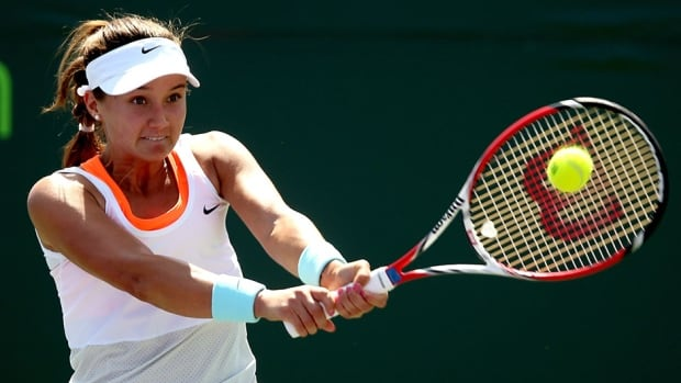 Lauren Davis returns a shot to Shuai Zhang of China during the Sony Open at the Crandon Park Tennis Center on March 19, 2014 in Key Biscayne, Fla.